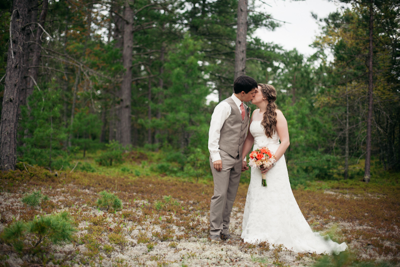 Bride and Groom in the forest kissing